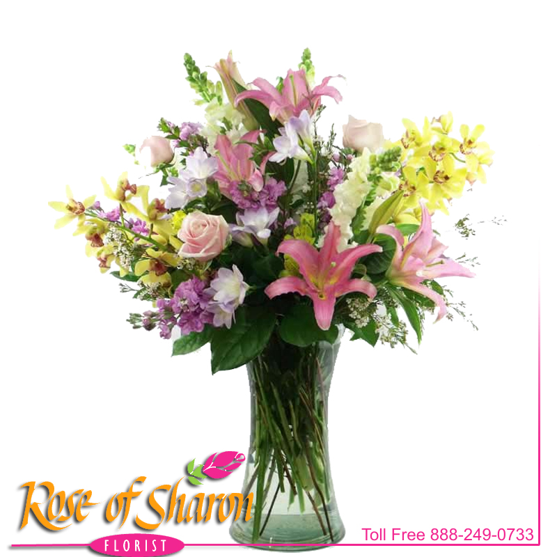 This impressive vase of flowers was created with Cymbidium Orchids, Roses, Orchid Lily, fragrant stock, snapdragons and more. A grand gesture of fragrant beauty.