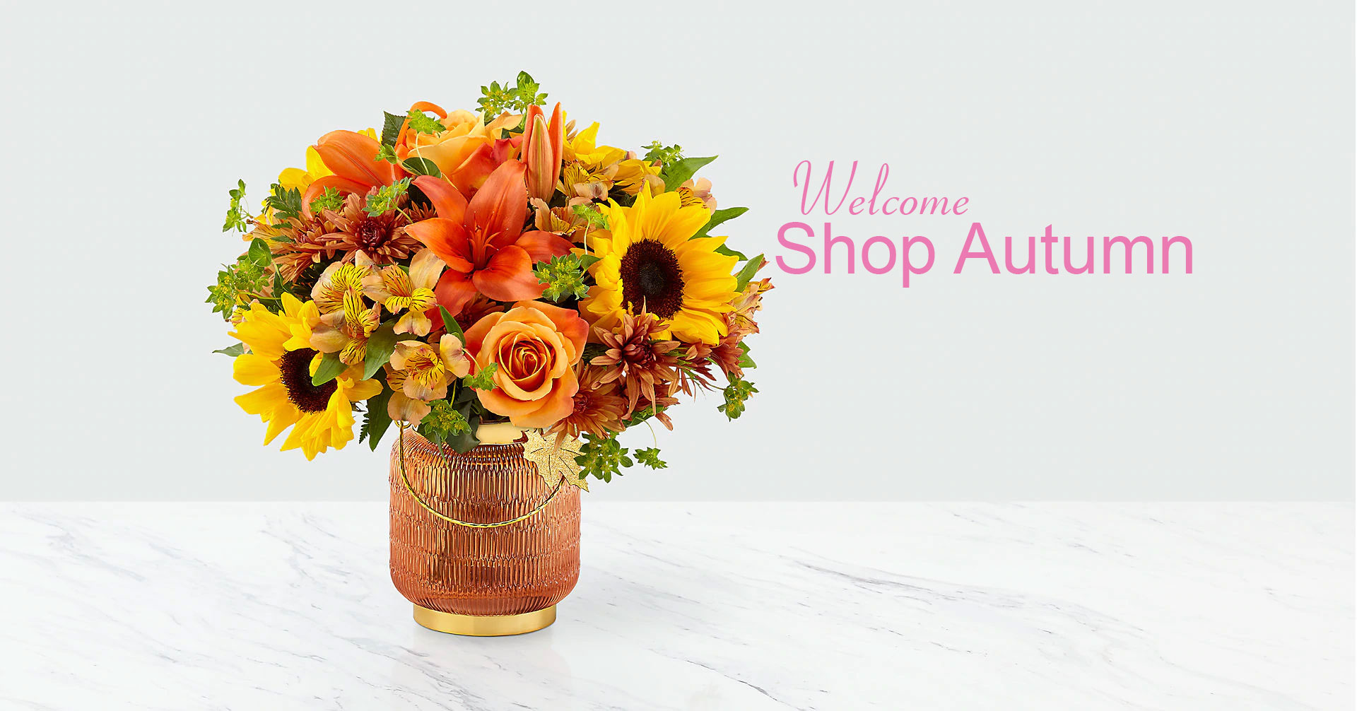 Autumn Moments, an autumnal mix of sunflowers, roses, asiatic lily and bupleurum in a gift-quality vase. Finished with a metal leaf.
