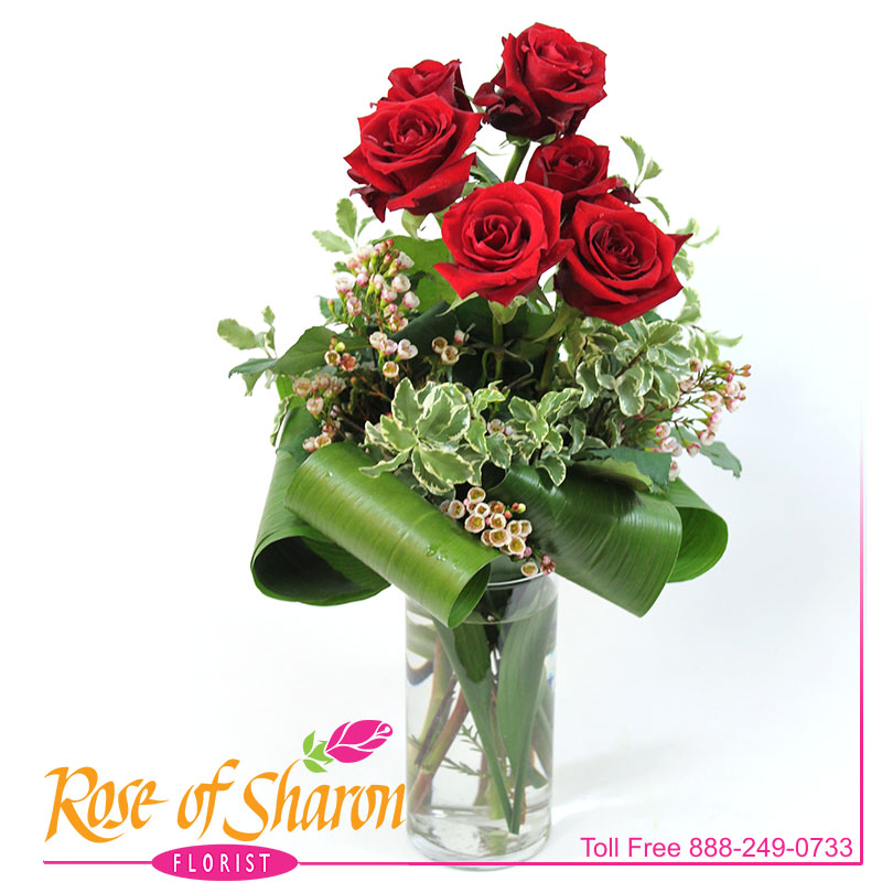 2487 Six Clutched Roses Image One
