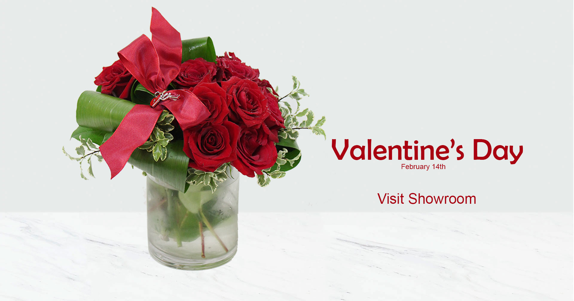 Valentina means love.This version is a gorgeous array of one dozen Red Velvet Roses framed by rolled, varigated ti leaves are placed in a clear, glass cube cylinder vase. This exquisite arrangement is finished with a satin bow and locket.
